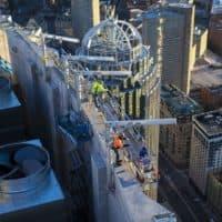 Contractors work on the top of One Dalton Street, 742 feet above Huntington Ave. (Jesse Costa/WBUR)