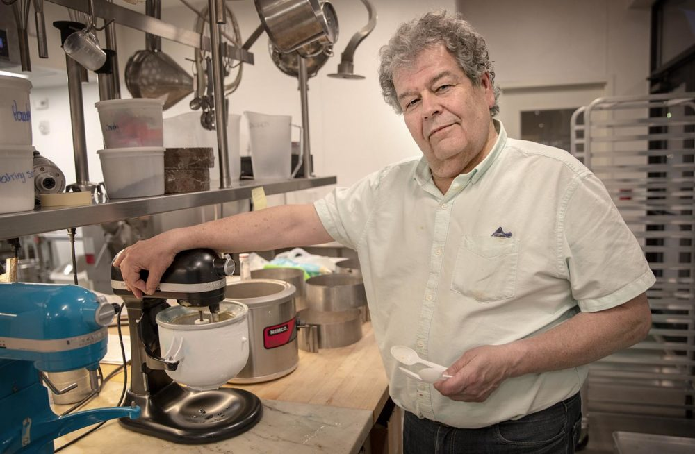 Gus Rancatore, one of the founders of Toscanini's, at the store's kitchen in Kendall Square. (Robin Lubbock/WBUR)
