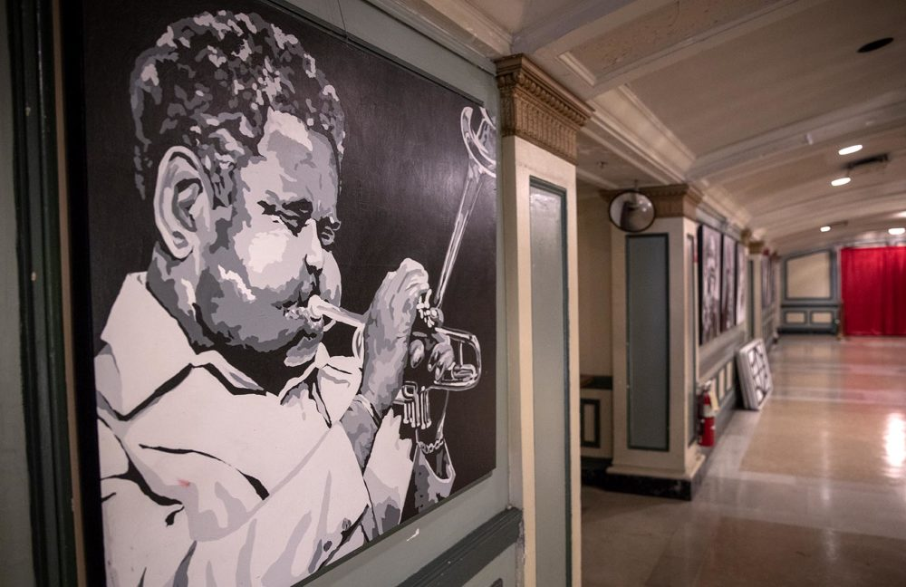 Jazz trumpeter Dizzy Gillespie is one of the many artists who played at the The Strand Theatre whose portraits now line the walls of the theater foyer. (Robin Lubbock/WBUR)