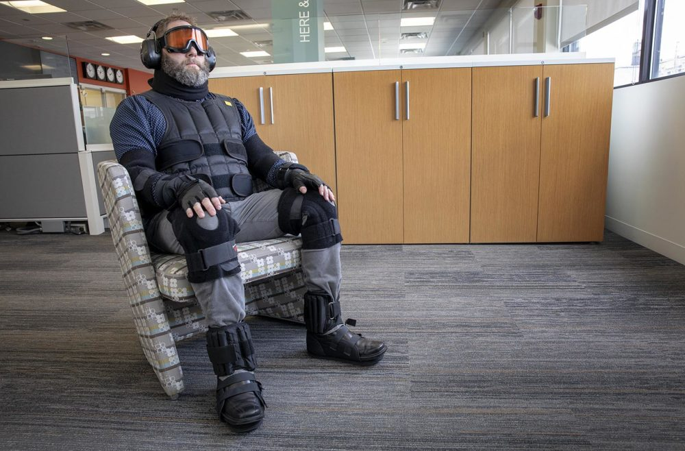 Corgan's Mike Steiner sits in the age suit, which both weighs you down and limits your mobility and sensitivity to the world around you. (Robin Lubbock/WBUR)
