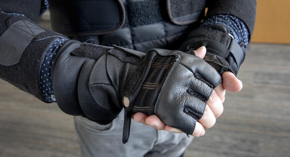 The age suit's wrist weights and gloves limit mobility and sensitivity in your arms and hands. (Robin Lubbock/WBUR)