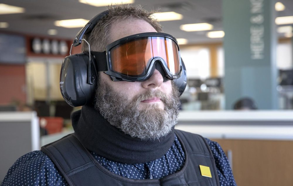 The age suit's goggles, ear muffs, neck brace and weighted jacket limit the wearer's freedom of movement and ability to sense the world. (Robin Lubbock/WBUR)