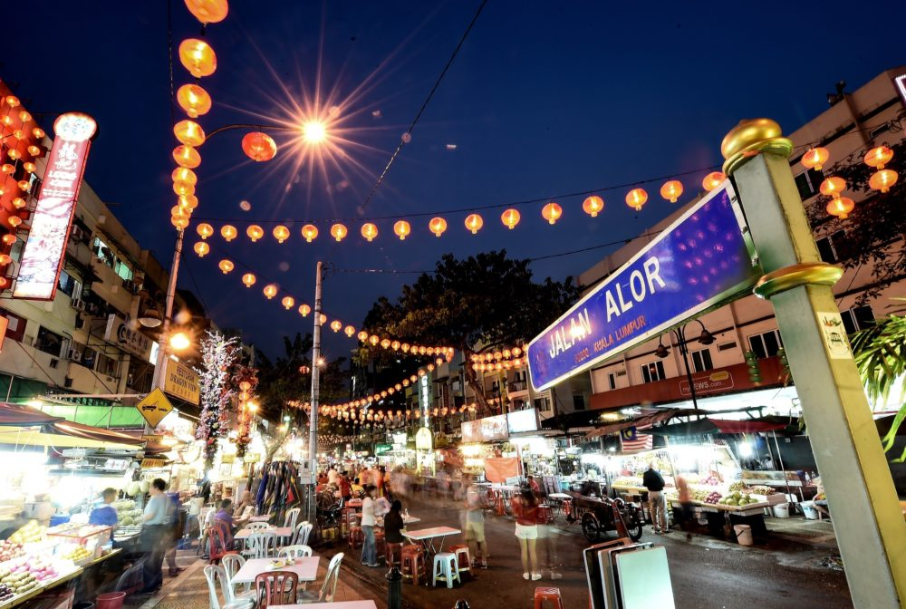 Foreign tourists and Malaysians visit the popular Jalan Alor food street in central Kuala Lumpur. (Manan Vatsyayana/AFP/Getty Images)