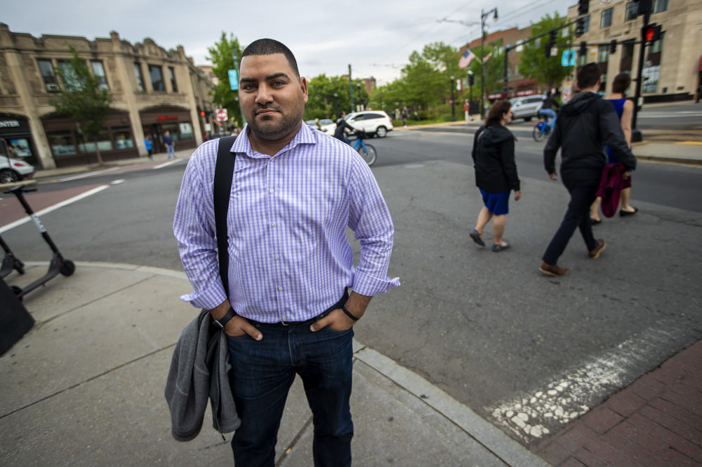 Raul Fernandez, seen here standing in Coolidge Corner, is the Brookline Select Board's first Latino member. (Jesse Costa/WBUR)