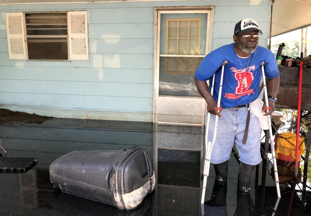 "Anderson Jones stands by his flooded home outside of Fitler, Miss. ""I tried to stay and hold on as long as I could,"" he says. (Peter O'Dowd/Here & Now)"