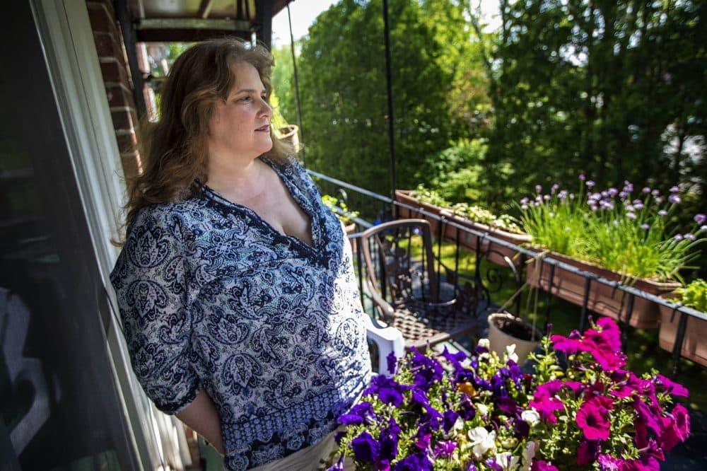 Diana Mamouni on the balcony of her condominium in North Andover. (Jesse Costa/WBUR)