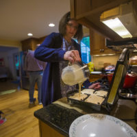 Kristin Heres makes waffles for her daughter Anya's breakfast. (Jesse Costa/WBUR)