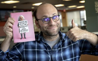 BoJack Horseman creator Raphael Bob-Waksberg gives a thumbs up to his new book. (Robin Lubbock/WBUR)