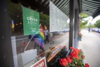 Signs are up in Boston establishments that used to be included in the Green Book. (Jesse Costa/WBUR)