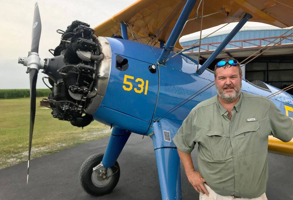 "After World War II, Jason Wade says this biplane was converted into a crop duster by the company that would eventually become Delta Airlines. Nearly 80 years after it was first built, Wade has meticulously maintained it. ""They're just good old stable airplanes,"" he says. (Peter O'Dowd/Here & Now)"