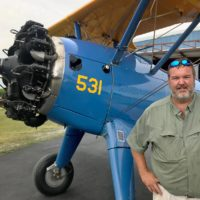 """After World War II, Jason Wade says this biplane was converted into a crop duster by the company that would eventually become Delta Airlines. Nearly 80 years after it was first built, Wade has meticulously maintained it. """"They're just good old stable airplanes,"""" he says. (Peter O'Dowd/Here & Now)"""