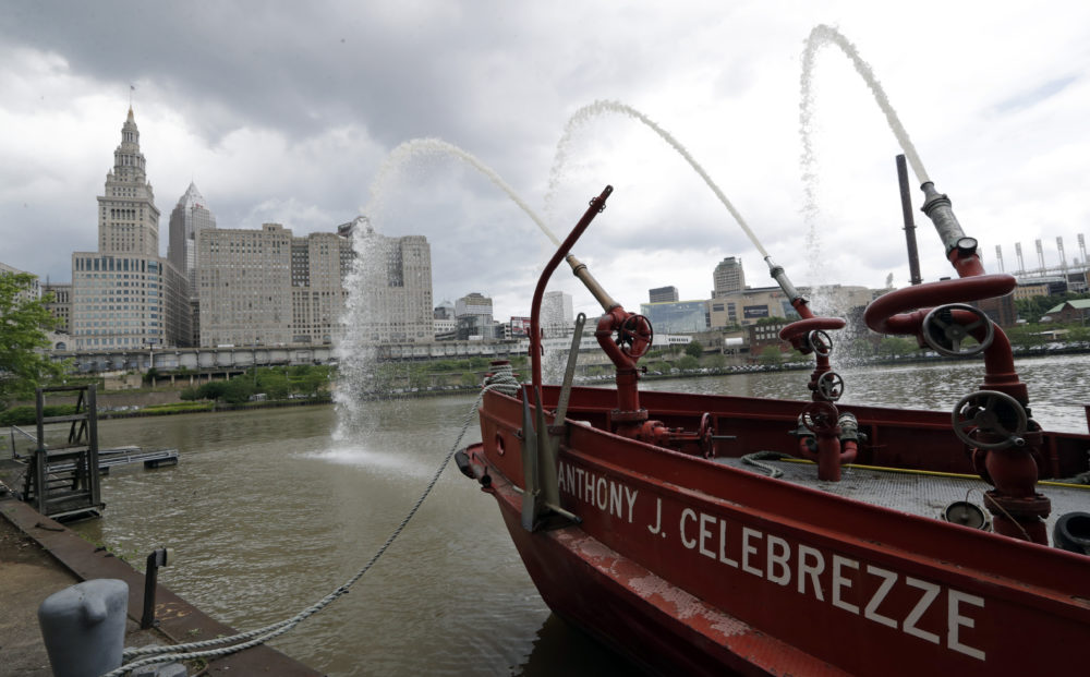 The Anthony J. Celebrezze rests near Fire Station 21 on the Cuyahoga River, Thursday, June 13, 2019, in Cleveland. Fire Station 21 battles the fires on the Cuyahoga River. The Celebrezze extinguished hot spots on a railroad bridge torched by burning fluids and debris on the Cuyahoga in 1969. (Tony Dejak/AP)