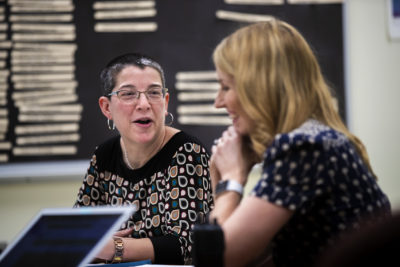 At a meeting at Boston English High School, Perille jokes with school principal Caitlin Murphy. (Jesse Costa/WBUR)