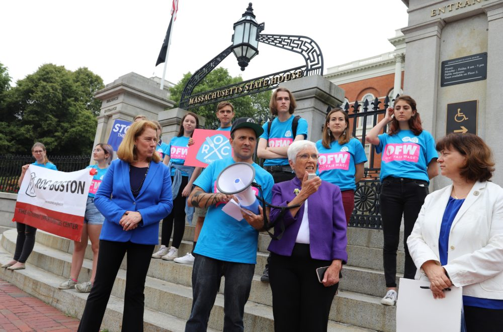 Sen. Patricia Jehlen (center), Rep. Tricia Farley-Bouvier (right), and U.S. Senate candidate Shannon Liss Riordan (left) rallied with activists in front of the State House on Tuesday in support of applying the standard minimum wage to tipped workers.  (Sam Doran/SHNS)