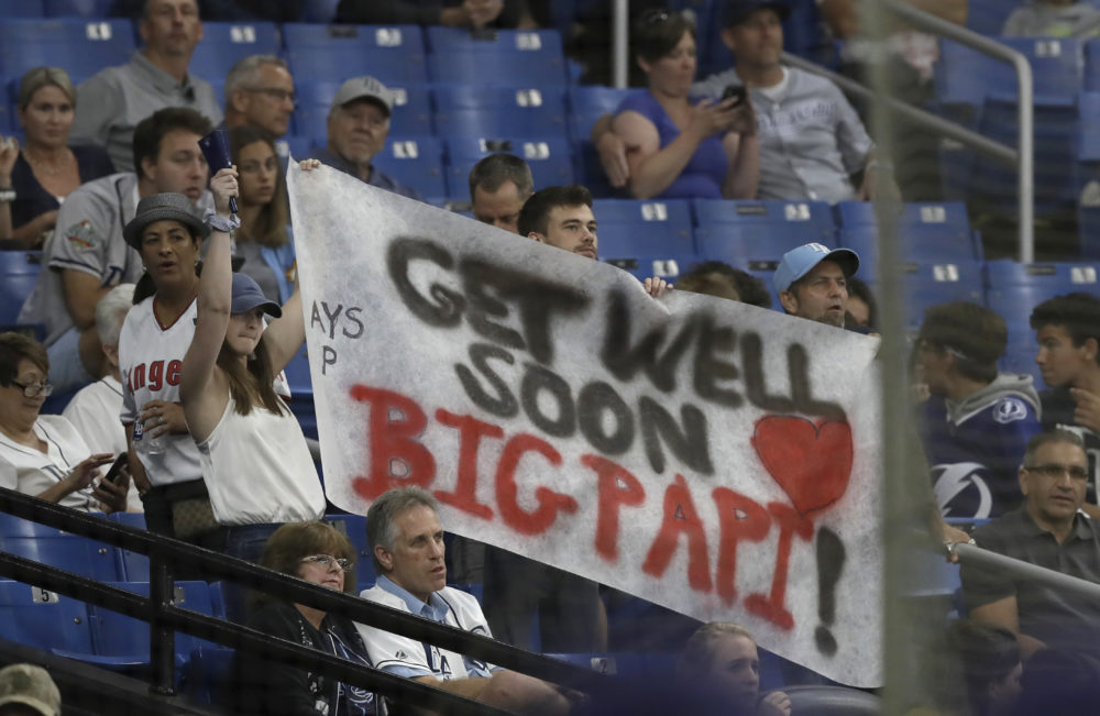 Tampa Bay Rays fans hold up a sign with encouraging words for former Boston Red Sox player David Ortiz during the Rays' game against the Los Angeles Angels on Thursday. (Chris O'Meara/AP)
