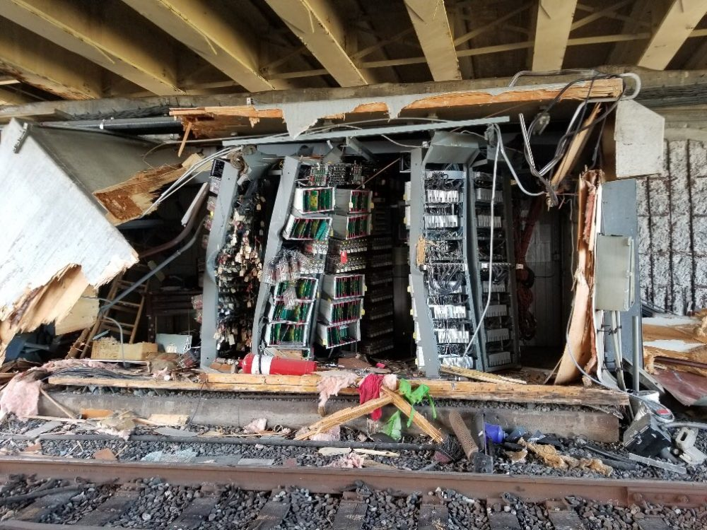 Structures that house MBTA signal equipment were badly damaged when a Red Line train derailed near JFK/UMass Station on June 11, 2019. (Courtesy MBTA)