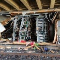 Structures that house MBTA signal equipment were badly damaged when a Red Line train derailed near JFK/UMass Station on June 11, 2019. (Courtesy MBTA)