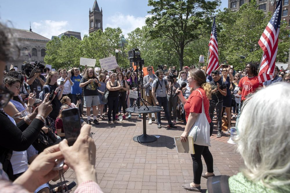 Madeline Howard, a product manager at Wayfair, addresses the crowd in Copley Square supporting a Wayfair staff walkout. (Robin Lubbock/WBUR)