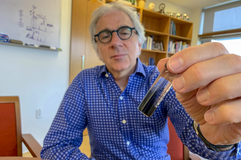 Harvard researcher Doug Melton holds a vial of insulin-producing cells made in his lab. (Karen Weintraub)