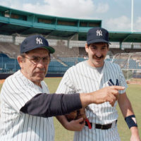 Yogi Berra with son Dale at the New York Yankees spring training in March 1985 in Florida.  (AP)
