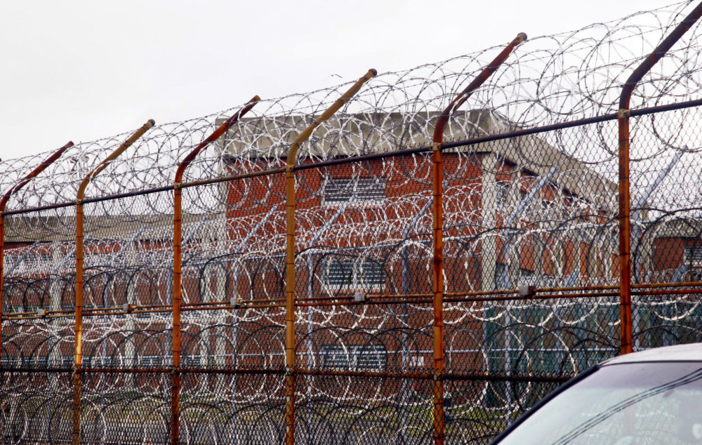 A security fence surrounds the inmate housing on New York's Rikers Island correctional facility. The state is poised to adopt new standards for solitary confinement in local jails at the urging of Democratic Gov. Andrew Cuomo. (Bebeto Matthews/AP)