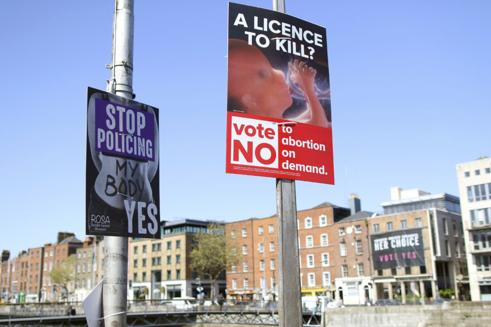 In this photo taken on May 17, 2018, pro and anti-abortion poster's on lampposts, in Dublin, Ireland. (Peter Morrison/AP)