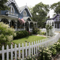 In this 2015 file photo, people walk near cottages in the Camp Meeting Association neighborhood of Oak Bluffs on the island of Martha's Vineyard. (Steven Senne/AP)
