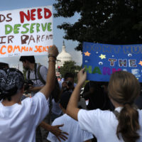Families march past the U.S. Capitol as they protest the separation of immigrant families, Thursday, July 26, 2018, in Washington. (Jacquelyn Martin/AP)