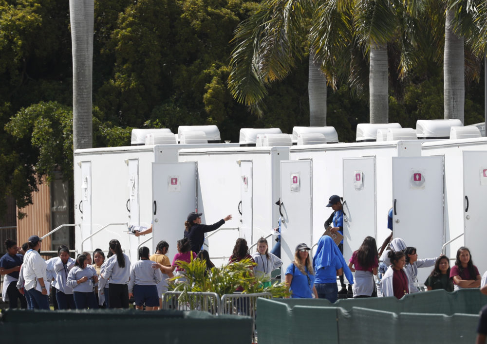 Migrant children stand outside portable restrooms at the Homestead Temporary Shelter for Unaccompanied Children, Monday, May 6, 2019, in Homestead, Fla. (Wilfredo Lee/AP)