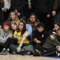 Young people console each other during a community vigil to honor the victims and survivors of a fatal shooting at the STEM School Highlands Ranch on May 8 in Highlands Ranch, Colo. (David Zalubowski/AP)