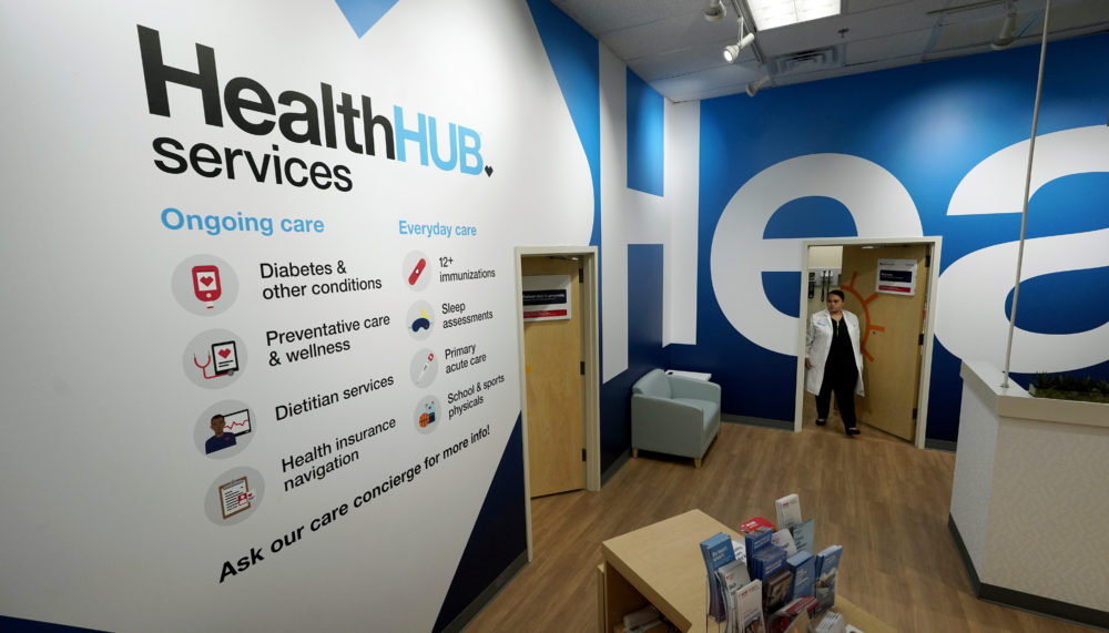 Family Nurse Practitioner Serena Lopez exits an exam room at the new HealthHUB inside a CVS store in Spring, Texas. (David J. Phillip/AP)