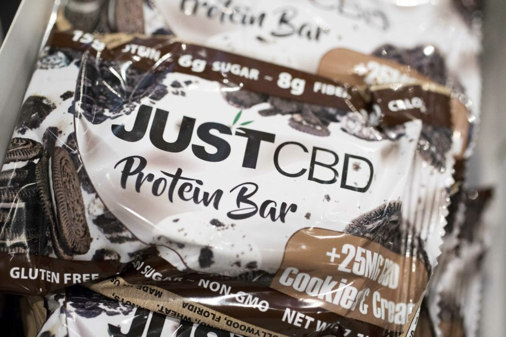 A cookies and cream-flavored protein bar marketed by JustCBD is displayed at the Cannabis World Congress & Business Exposition trade show on May 30 in New York. (Mark Lennihan/AP)