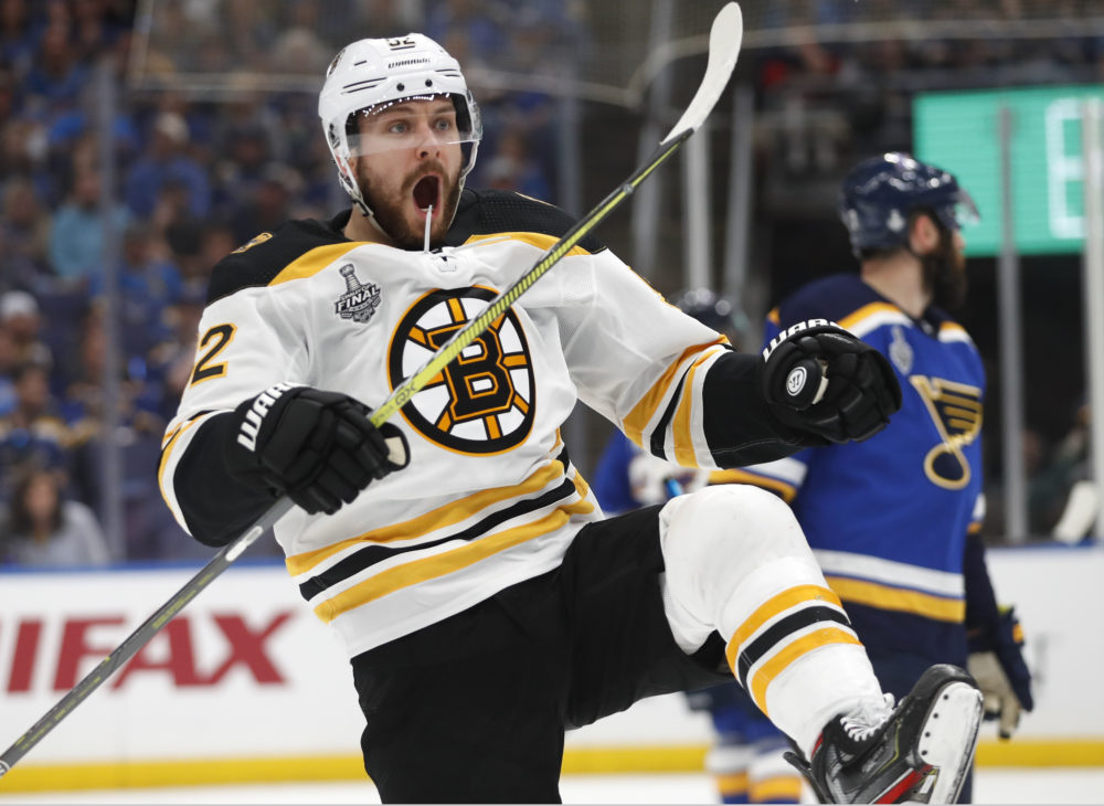 Boston Bruins center Sean Kuraly (52) celebrates after scoring a goal against the St. Louis Blues during the first period of Game 3 of the NHL hockey Stanley Cup Final Saturday, June 1, 2019, in St. Louis. (Jeff Roberson/AP)