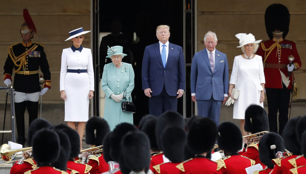 Britain's Queen Elizabeth II stands with President Donald Trump, center, and first lady Melania Trump, left, Britain's Prince Charles and Camilla, Duchess of Cornwall, right, during a ceremonial welcome in the garden of Buckingham Palace in London, Monday, June 3, 2019 on the opening day of a three day state visit to Britain. (Frank Augstein/AP)