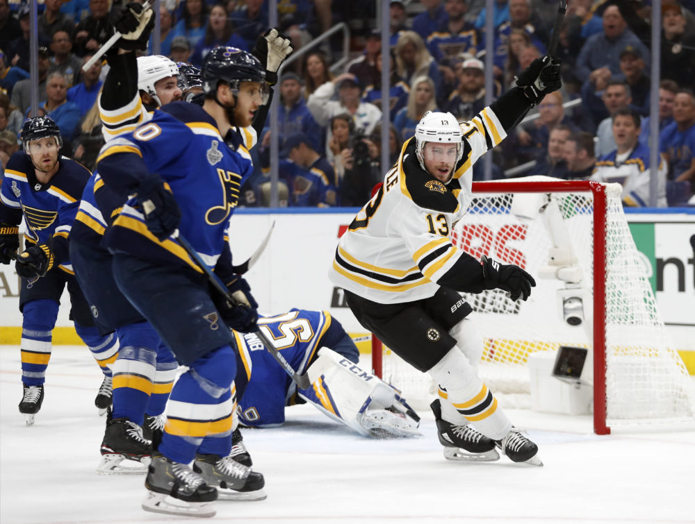 Boston Bruins center Charlie Coyle (13) celebrates after scoring against St. Louis Blues goaltender Jordan Binnington (50) during the first period of Game 4 of the NHL hockey Stanley Cup Final Monday, June 3, 2019, in St. Louis. (Jeff Roberson/AP)