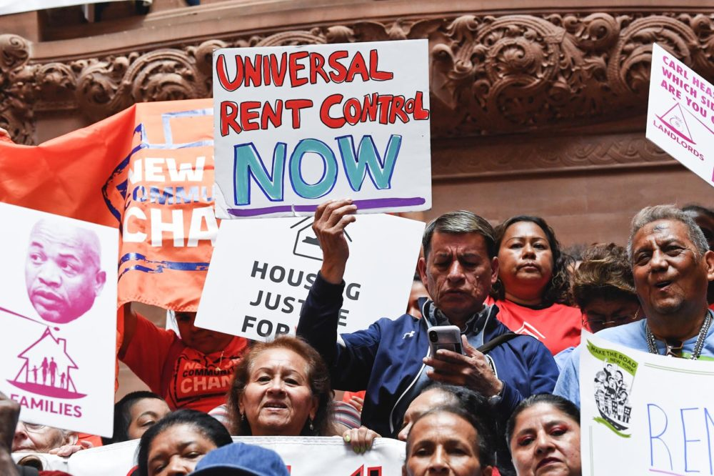 Tenants and members of the Upstate Downstate Housing Alliance from across the state demand New York Gov. Andrew Cuomo and state legislators pass universal rent control legislation at the state Capitol Tuesday, June 4, 2019, in Albany, N.Y. (Hans Pennink/AP)