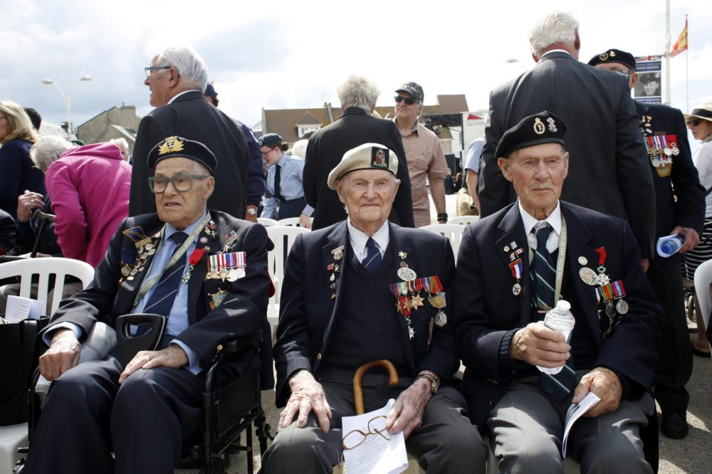 British D-Day veteran Cyril Banks, center, sits with two fellow veterans during an event to mark the 75th anniversary of D-Day in Arromanches, Normandy, France, Thursday, June 6, 2019. (Thibault Camus/AP)