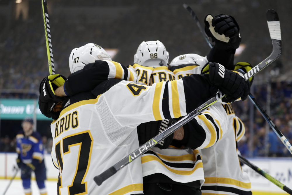 Boston Bruins right wing David Pastrnak (88), of the Czech Republic, celebrates after scoring against the St. Louis Blues during the third period of Game 6 of the NHL hockey Stanley Cup Final Sunday in St. Louis. (Jeff Roberson/AP)