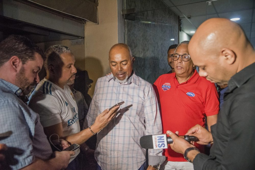 Leo Ortiz, center, father of David Ortiz, talks with journalists at the hospital where his son was hospitalized after being shot. (Ricardo Hernandez/AP)