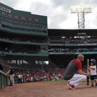 Boston Red Sox pitcher David Price plays with his son, Xavier before a game against the Texas Rangers at Fenway Park on Monday, June 10. (Charles Krupa/AP)