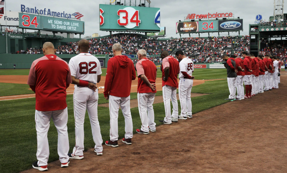 The Boston Red Sox and fans pause for a moment for Ortiz, who was shot Sunday evening in the Dominican Republic, prior to a game Monday against the Texas Rangers. (Charles Krupa/AP)
