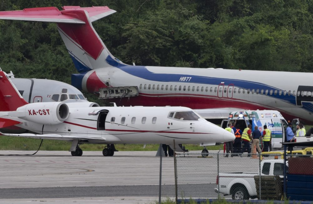 The ambulance carrying David Ortiz is parked next to a small ambulance plane that would fly him to Boston, at Las Americas Airport in Santo Domingo, Dominican Republic. (Juan Miguel Pena/AP)