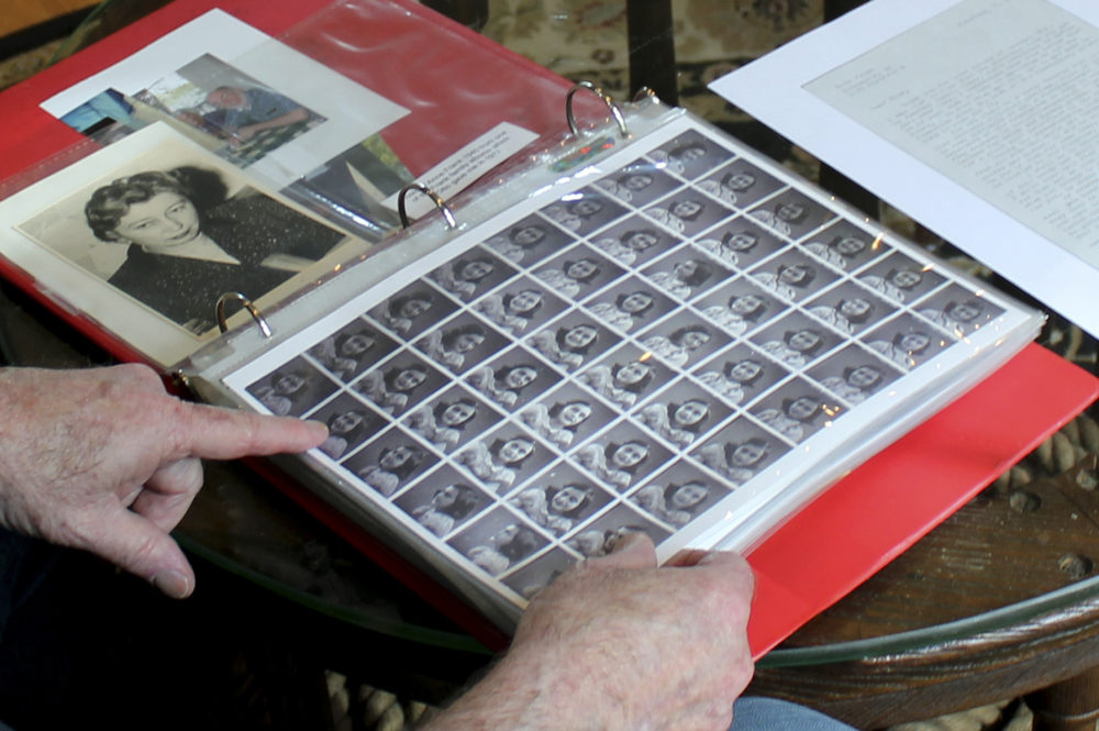 Ryan Cooper shows photos of Anne Frank that he kept in a scrapbook at his home in Yarmouth, Mass. The 48 small images were made in a photo booth in 1940. (Philip Marcelo/AP)