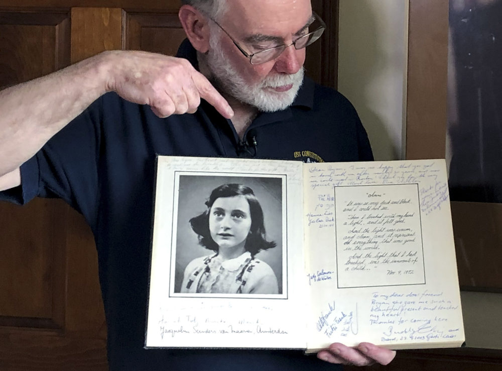 Ryan Cooper holds a 1972 portion of a diary that he wrote when he visited Otto Frank, the father of the famed Holocaust victim and diarist Anne Frank, at his home in Yarmouth, Mass. Cooper has donated a trove of letters and mementos to the U.S. Holocaust Memorial Museum (Philip Marcelo/AP)