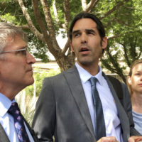 Scott Warren, center, speaks outside federal court, Tuesday, June 11, 2019. in Tucson, Ariz., after a mistrial was declared in the federal case against him. (Astrid Galvan/AP)