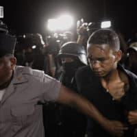 Eddy Vladimir Feliz Garcia, in custody in connection with the shooting of David Ortiz, is transferred by police to court in Santo Domingo, Dominican Republic, on Tuesday. (Roberto Guzman/AP)