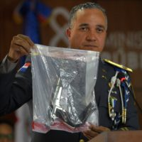 The director of the National Police, General Ney Aldrin Bautista Almonte, shows the weapon that was used to shoot former Boston Red Sox slugger David Ortiz, during a press conference in Santo Domingo, Dominican Republic, on Wednesday. (Roberto Guzman/AP)