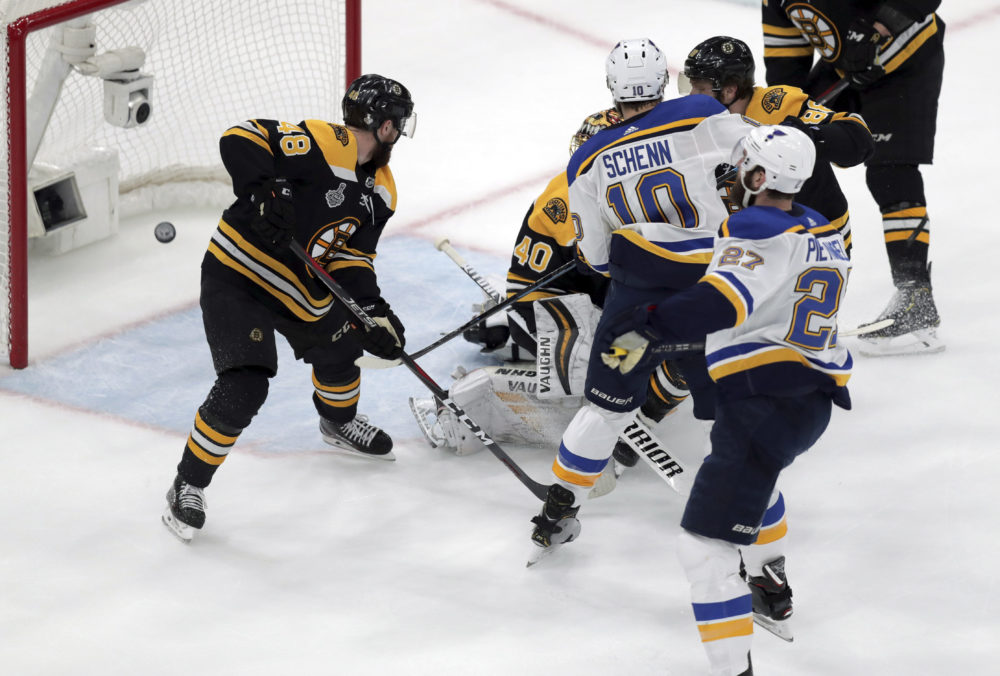 St. Louis Blues' Alex Pietrangelo, right, watches his shot sail into the net behind Boston Bruins goaltender Tuukka Rask during the first period in Game 7 Wednesday in Boston. (Charles Krupa/AP)