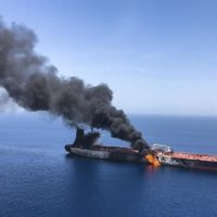 An oil tanker is on fire in the sea of Oman, Thursday, June 13, 2019. Two oil tankers near the strategic Strait of Hormuz were reportedly attacked on Thursday, an assault that left one ablaze and adrift as sailors were evacuated from both vessels and the U.S. Navy rushed to assist amid heightened tensions between Washington and Tehran. (ISNA/AP)