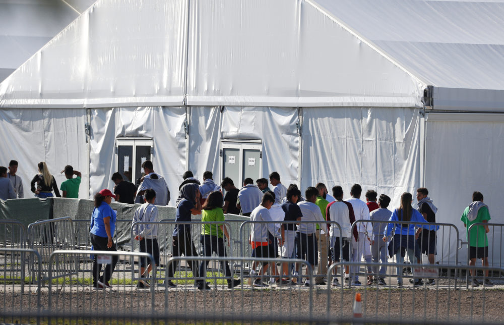 In this Feb. 19, 2019 file photo, children line up to enter a tent at the Homestead Temporary Shelter for Unaccompanied Children in Homestead, Fla. (Wilfredo Lee/AP)